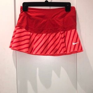 Nike. Dry fit tennis skirt. Coral red pleated